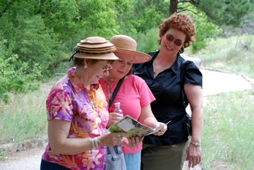 visitors with a trail guide