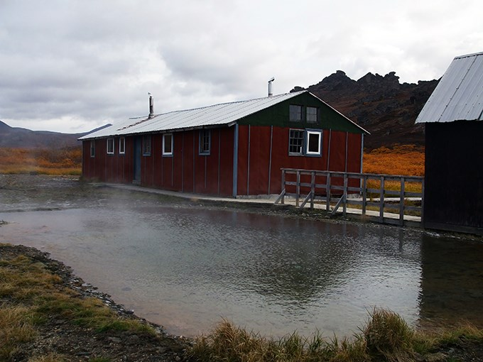 The bunkhouse at Serpentine Hot Springs with the tors in the distance.