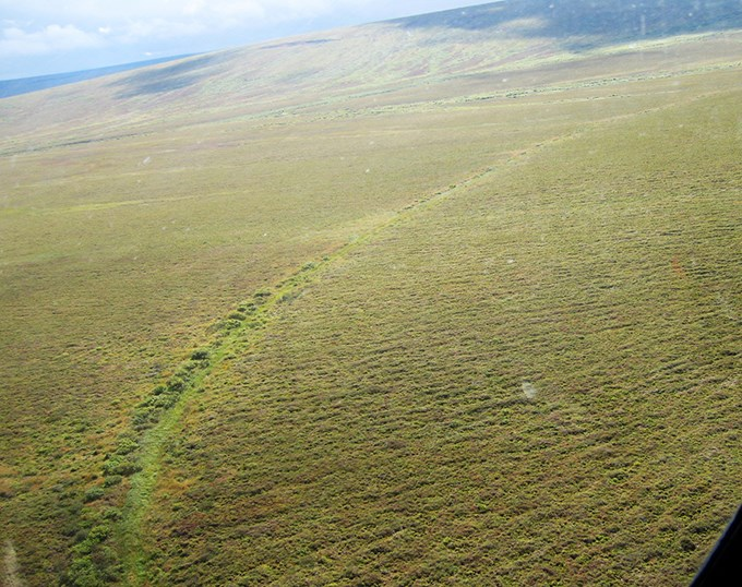 An aerial view of part part of Fairhaven Ditch showing a long ditch cutting through the tundra.