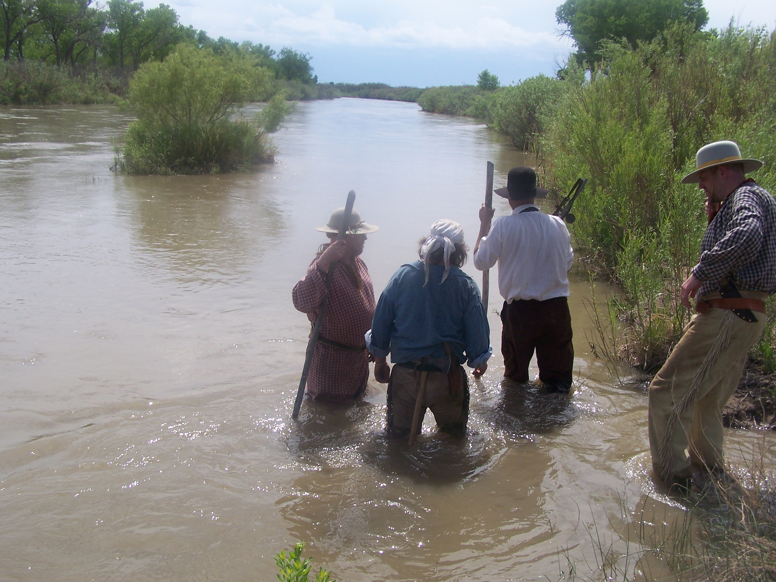trappers setting traps in river