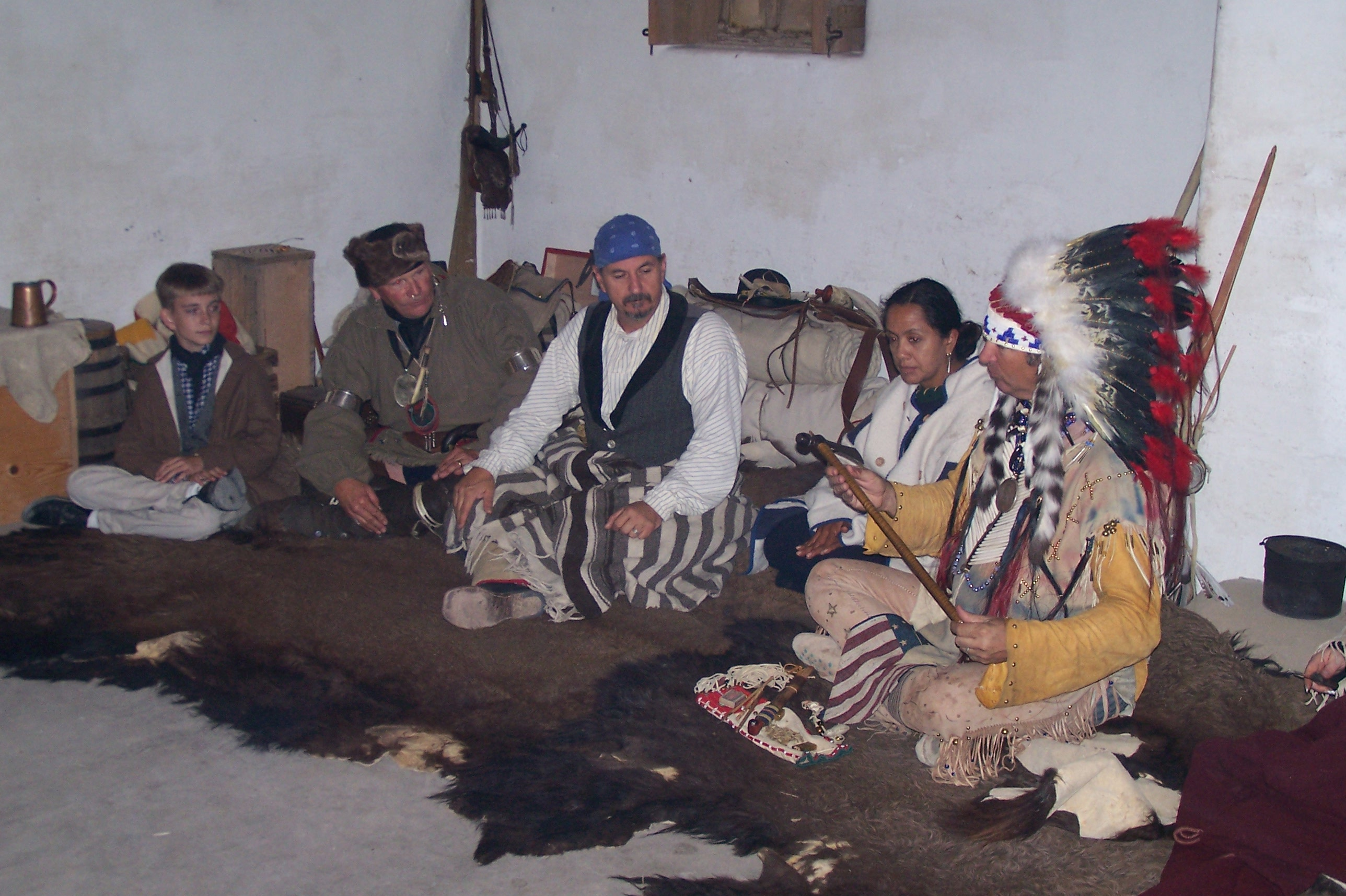 Cheyenne and traders conduct trade in the fort council room