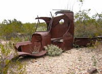 Old car rusting in the desert