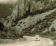 Car driving down the Basin Road, late 1930s.