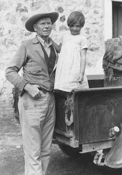 Everett Townsend with Blanca, a Mexican child in Boquillas, Mexico, 1936.