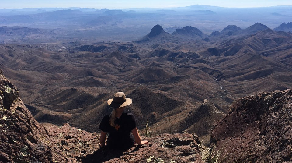 Hiker enjoying the view from the South Rim of the Chisos.
