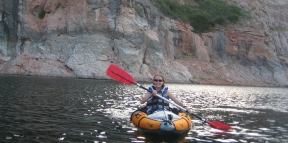 Visitor enjoys kayaking through the canyon