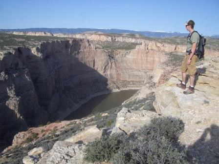 Hiker on the edge of Bighorn Canyon