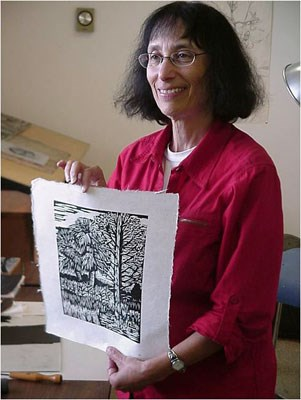 Artist-in-Residence Molly Doctrow demonstrates her wood cut ink print art.