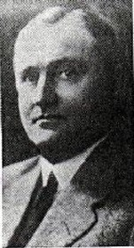 A grainy black and white image of Walter G. Langford wearing a suit.