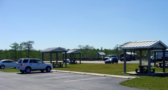 Cars parked near shaded picnic tables at Kirby Storter Roadside Park.