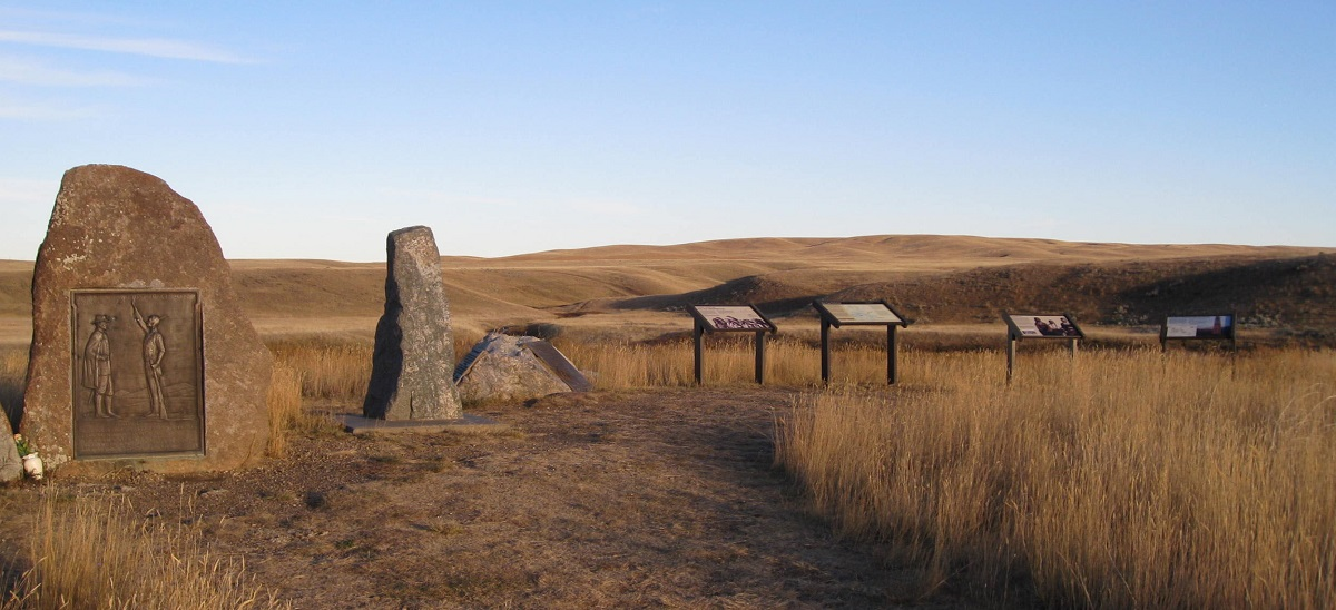 photo of stone monuments and information signs overlooking rolling hills in fall color.