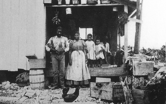 A young Jones family on the porch of their home on Porgy Key.