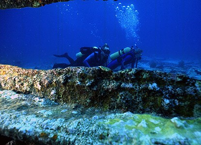SCUBA divers explore the wreck of the <i>Alicia</i>.