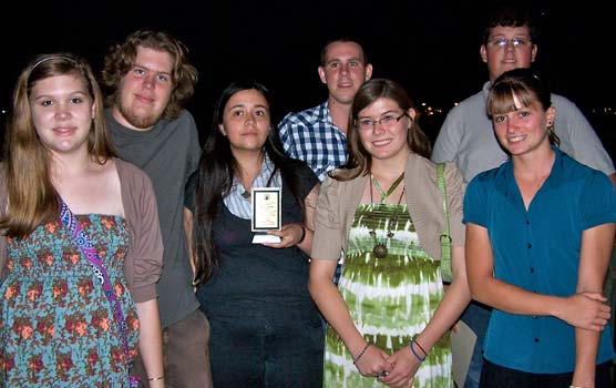 Seven students pictured with the Sierra Club Green Award trophy.