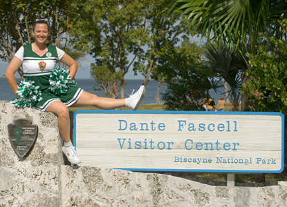 A very enthusiastic cheerleader welcomes participants to the Reef Rally Family Fun Fest.