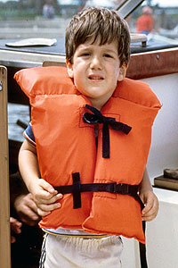 Young boy wearing lifejacket