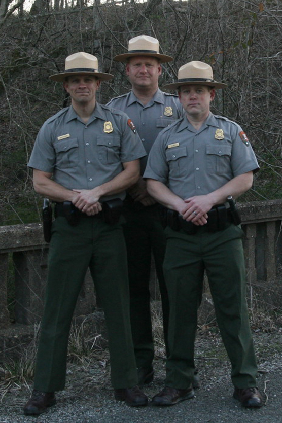 Three park rangers in uniform