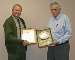 Ron Cornelius receives award for 40 years of Federal service.