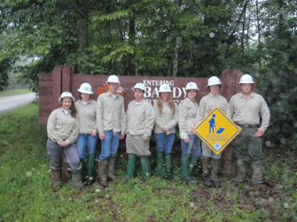 TN YCC youth standing in front of Big South Fork sign