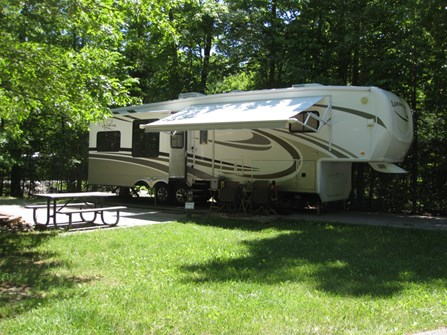 RV Camper Parked On Campsite