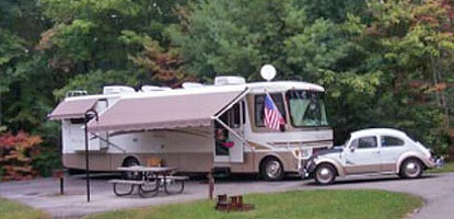 RV and car in camping station