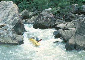 Canoe overturning at Devils Jump Rapids on Big South Fork River.