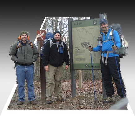 hikers standing in front of sign