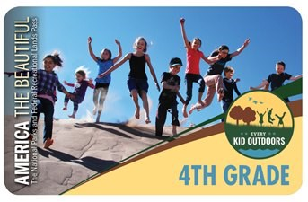 Every Kid Outdoors Pass showing kids running down a sand dune.