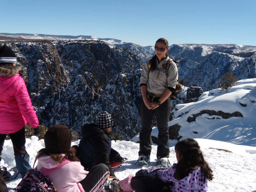 Volunteer Amanda Sweeney leads snowshoe program