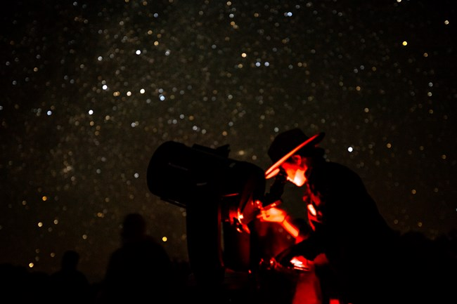 Ranger looking through telescope