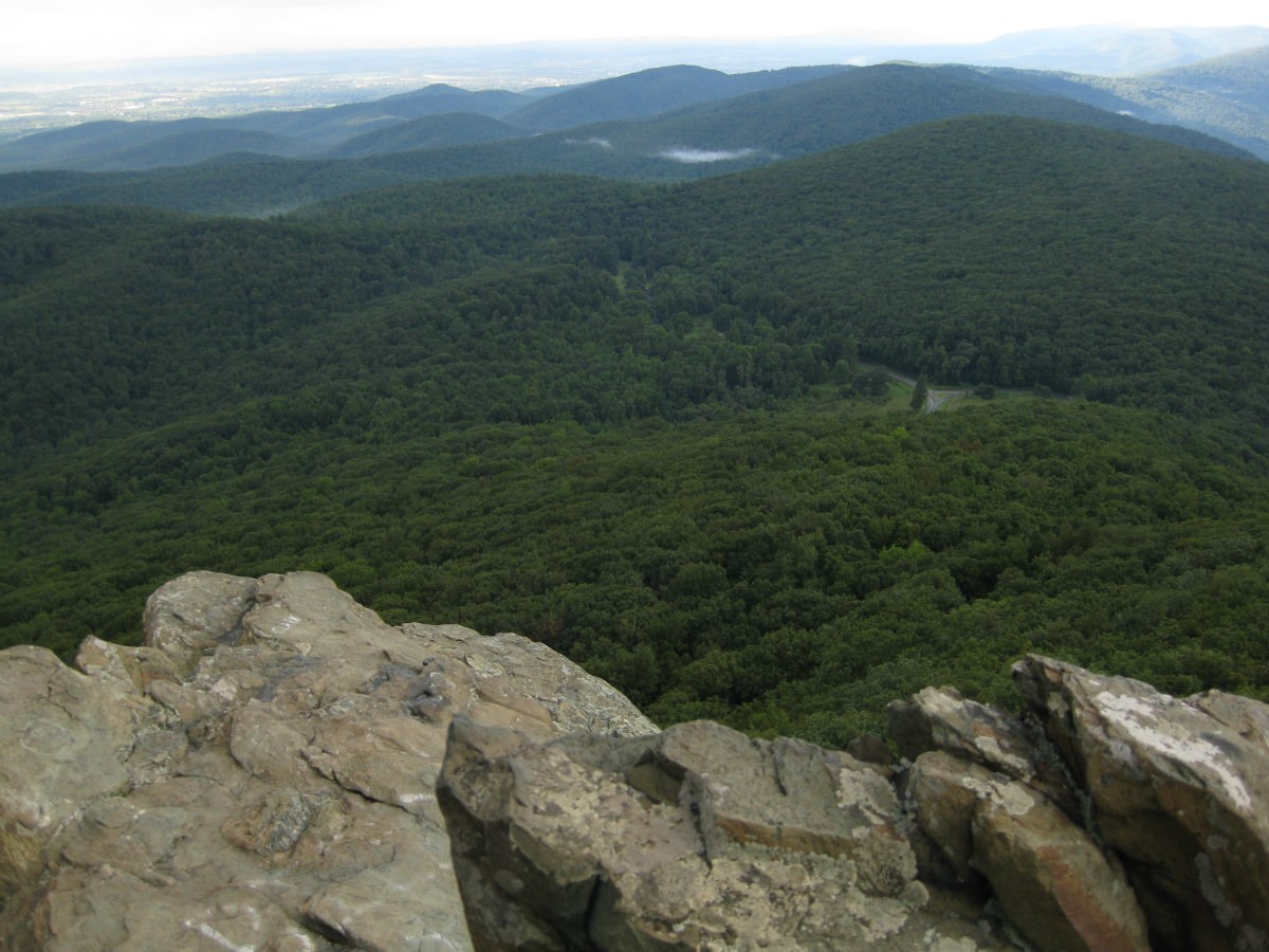 Sweeping view of green hills below from Humpback Rocks