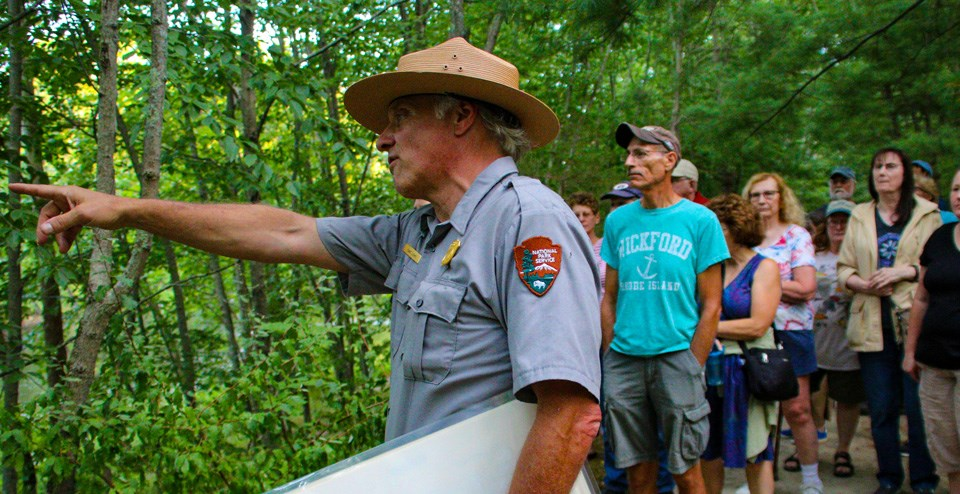 Ranger David pointing and showing visitors where to look