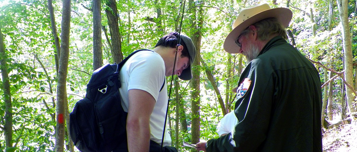 Ranger Richard talks with a fisherman along the Turnpike Trail