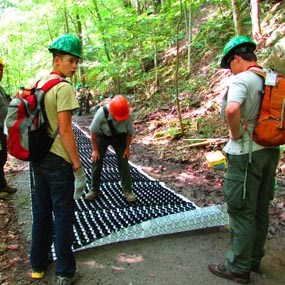 volunteers constructing an accessible trail