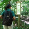 hiker reading trail sign