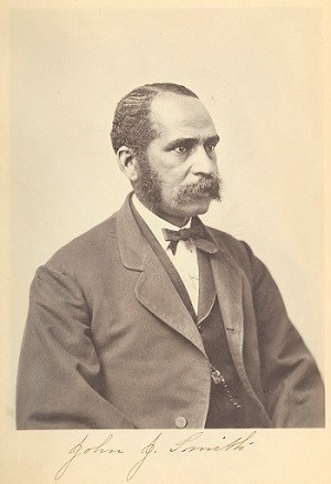 portrait of mustached African American man wearing a three piece suit