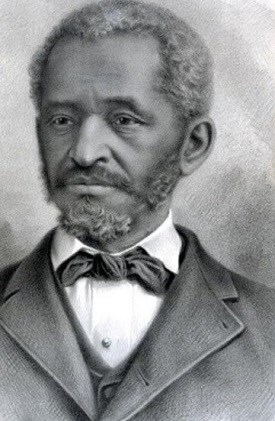 Portrait of african american man with short cropped hair and short facial hair.