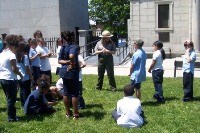 "A Ranger engages in the ""Patriots of Color"" program with students"