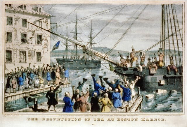 Men dressed as American Indians are on a ship center right throwing chests overboard while colonists on wharves in foreground and on left cheer in support. Another ship in background shows silhouette of more men dumping chests.