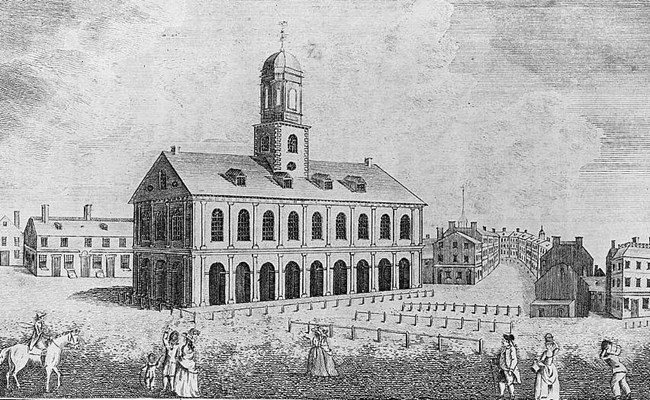 Print from an engraving of Colonial-era Faneuil Hall standing two stories high with a cupola in the center of the building.