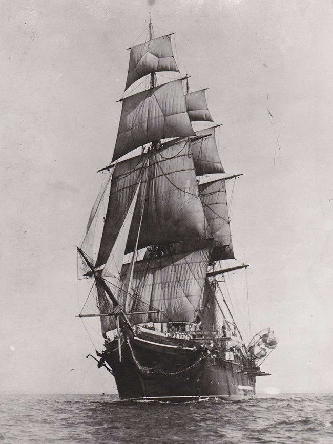 Photograph of USS Hartford sailing with full rigging.