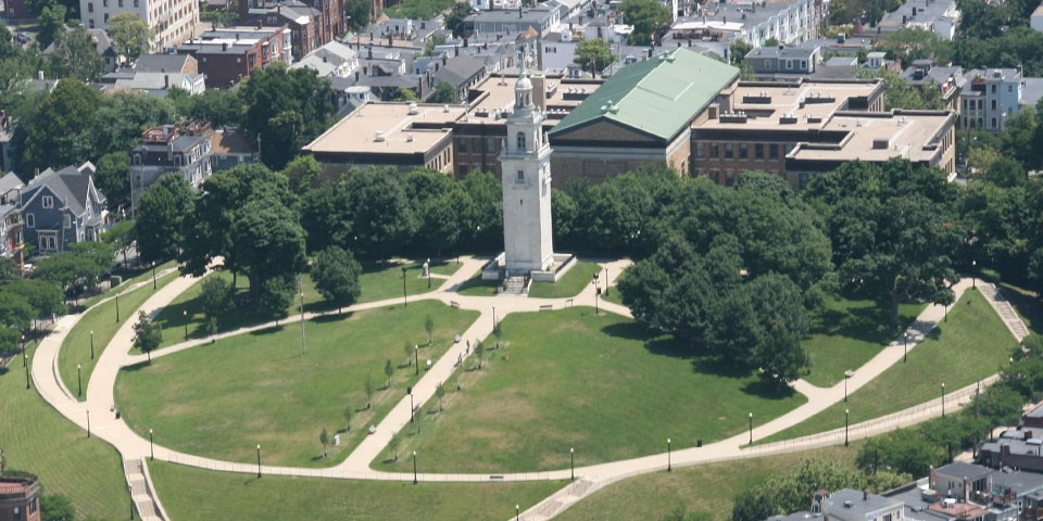Aerial photograph showing white marble monument in an elliptical park. Sidewalks wind around the ellipse and up the center toward the monument.