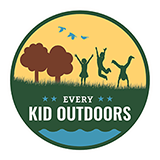 Every Kid Outdoors Logo showing a silhouette of trees and kids having fun