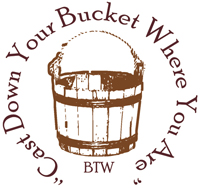 "Bucket with the words ""Cast Down Your Bucket Where You Are"" encircling it."