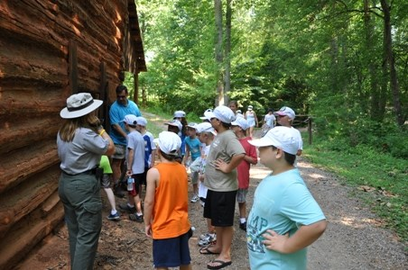 Children learning about the Tobacco Barn