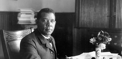 Booker T. Washington sitting at desk