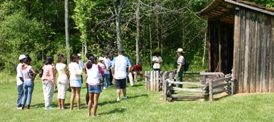 Park Ranger with tour group at Blacksmith Shed.