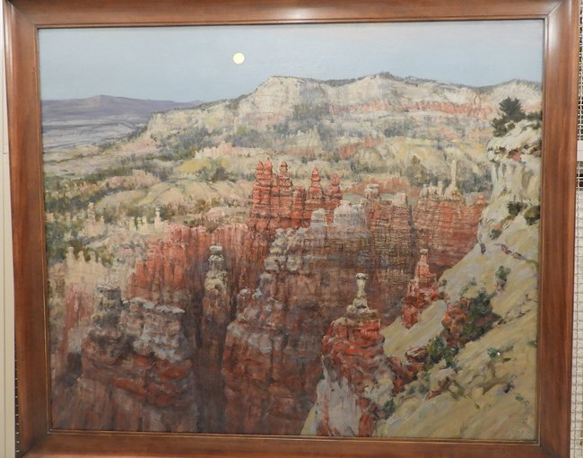 Painting by Howard Russell Butler of a full moon rising over the read and white rocks of Bryce Canyon