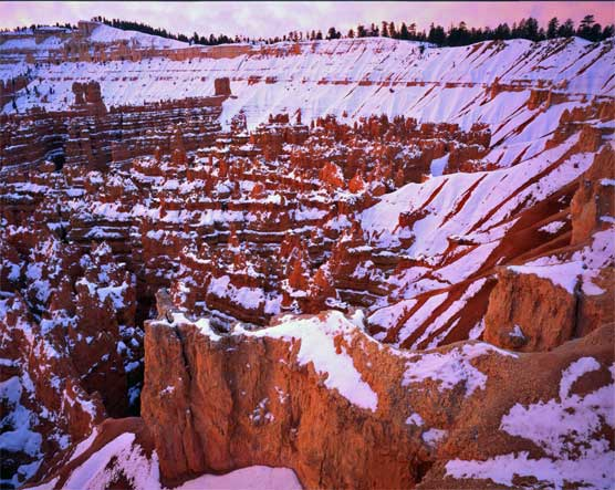 View from Sunset Point, snow blankets the hoodoos