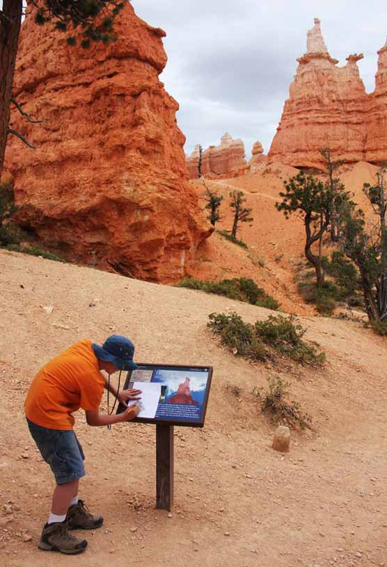 youth hiking the hoodoos, on the Queen's Garden Trail in Bryce Canyon